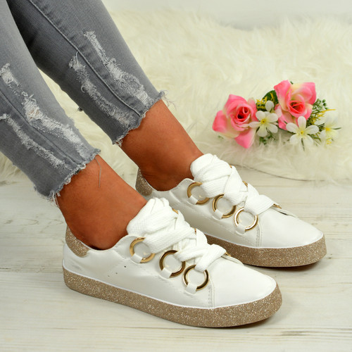 Brittany White with Gold Trainers