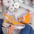 Disso Orange Glitter Wedge Trainers