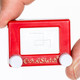 World's Smallest Etch-A-Sketch in hand