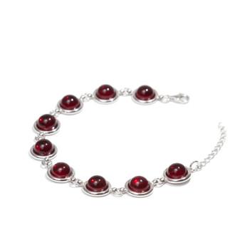 Nine cherry amber cabochons set in rhodium plated silver bracelet. vitality bracelet