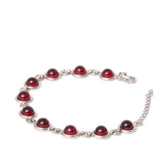 Ten small cherry amber cabochons set in rhodium plated silver bracelet.