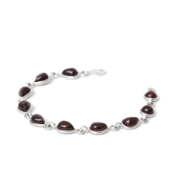 Small cherry amber teardrops set in rhodium plated silver bracelet.
