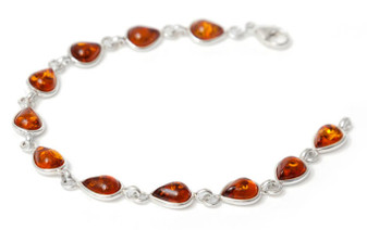 Small honey amber teardrops set in rhodium plated silver vitality bracelet.