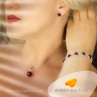Amber jewellery collection. Cherry amber and silver. Beautiful amber ball of pendant and half-ball in silver of bracelet and earrings.  Silver Snake Chain on the picture.
