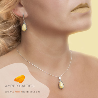 Amber jewelry set. Yellow, milky Baltic amber. Amber and sliver earrings and pendant.