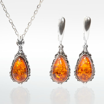 Cognac amber jewelry set. Pendant with silver chain and earrings