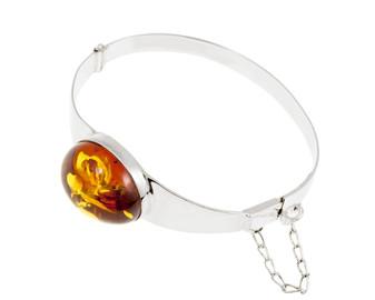 Sliver and cognac amber bracelet.