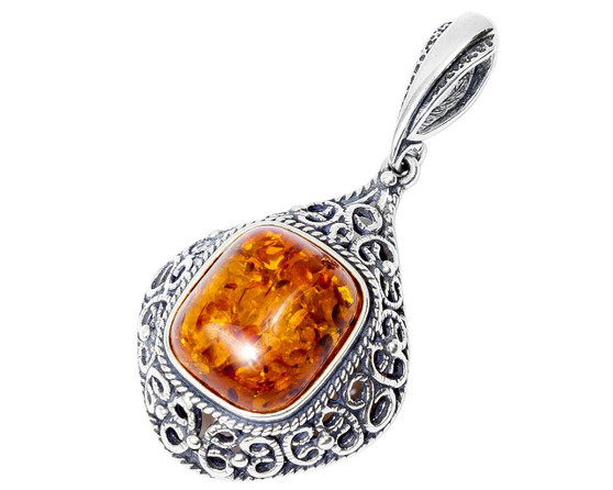 Silver and Baltic Honey Amber Pendant. Silver frame. Royal vintage style.