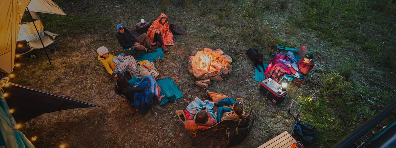 Overhead view of campers by a fire