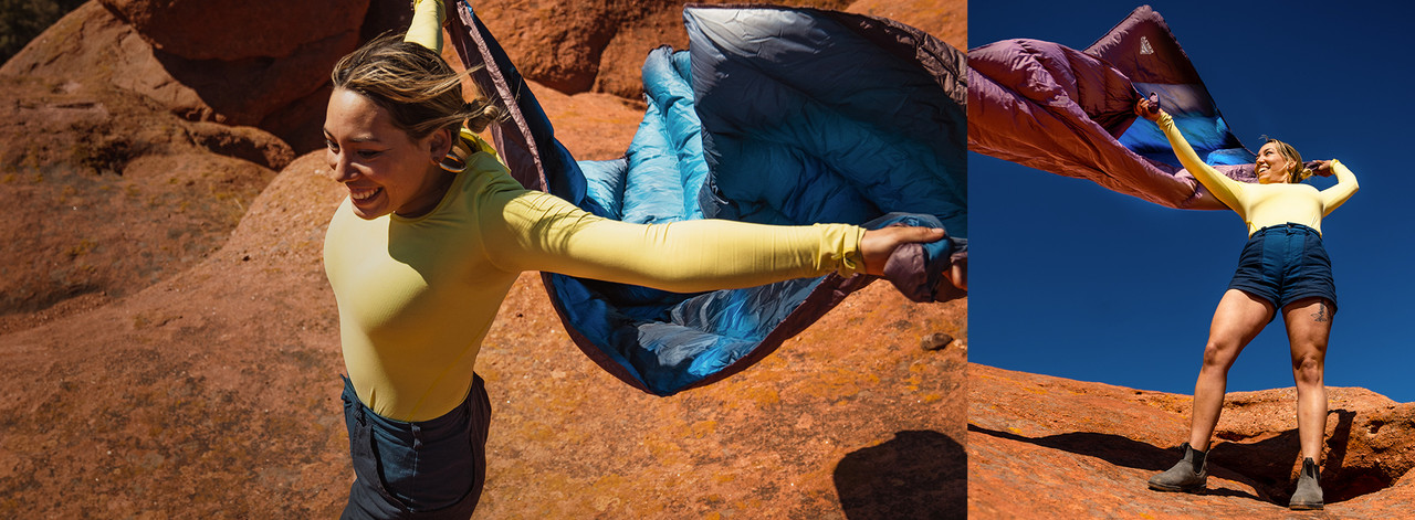 Woman holding a Kelty blanket that is blowing in the wind