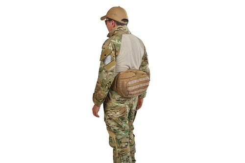 Soldier wearing lid from Kelty Falcon 4000 backpack on his waist, fanny-pack style