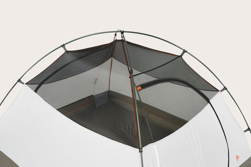 Close up of the top of Kelty Outfitter Pro 3 person tent, showing grey mesh at the top of the tent body, and two tent poles attached with color-coded plastic clips