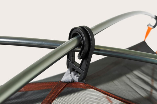 Close up of the Kelty Outfitter Pro 2 person tent, showing how the two tent poles are secured at the top of the tent with 2 opposing hook-shaped plastic clips