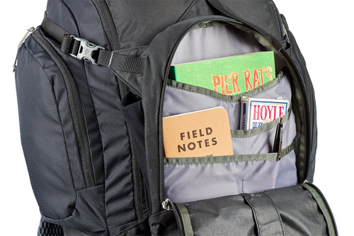 Close up of Kelty Redwing 50 backpack, with front pocket unzipped showing multiple small storage pockets inside