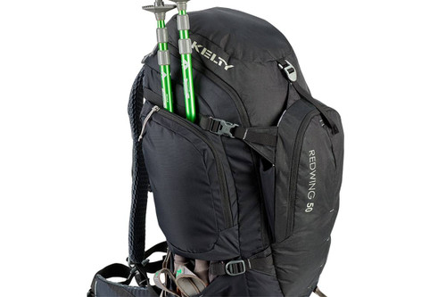 Kelty Redwing 50 backpack, top/side view, showing trekking poles packed behind the side storage pocket