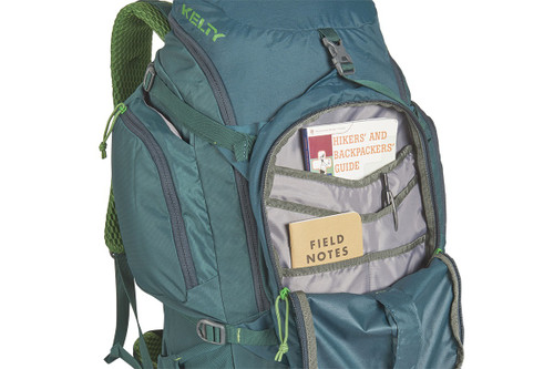 Close up of Kelty Redwing 44 backpack, with front pocket unzipped showing multiple small storage pockets inside
