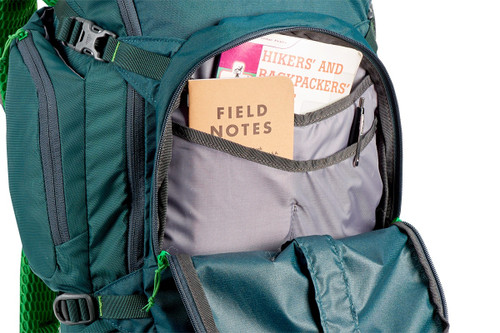 Close up of Kelty Redwing 32 backpack, with front pocket unzipped showing multiple small storage pockets