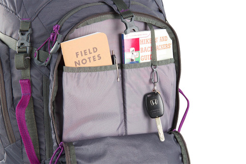 Close up of Women's Coyote 70 backpack, showing multiple interior storage pockets