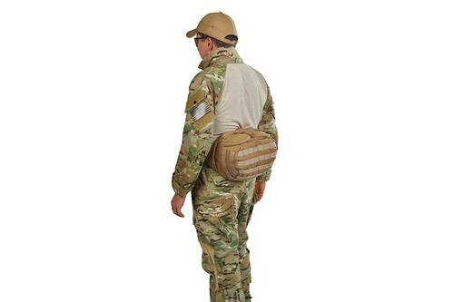 Soldier wearing lid from Kelty Falcon 4000 USA backpack on his waist, fanny-pack style