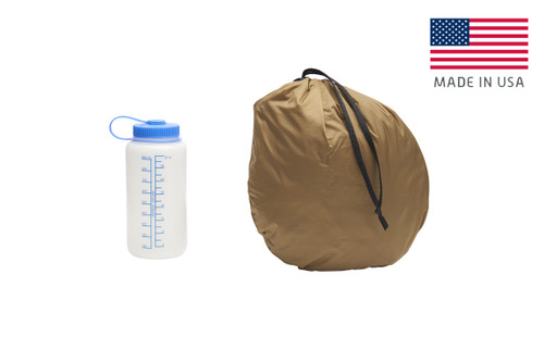 Kelty VariCom No Fly Zone USA bivy, shown packed inside of storage bag, bag standing on end next to 32 oz. water bottle