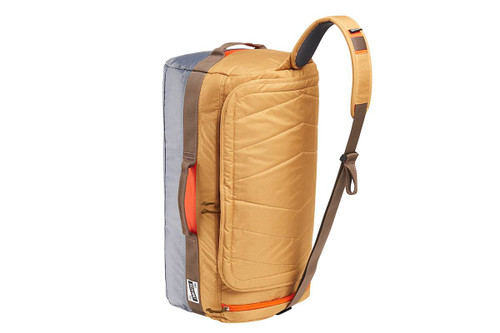 Kelty Dodger Duffel bag, Canyon Brown/Castle Rock, standing on its end, showing shoulder strap with pad
