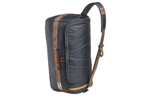 Kelty Dodger Duffel bag, Black Geo-Heather, standing on its end, showing shoulder strap with pad