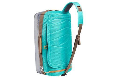 Kelty Dodger Duffel bag, Latigo Bay/Castle Rock, standing on its end, showing shoulder strap with pad