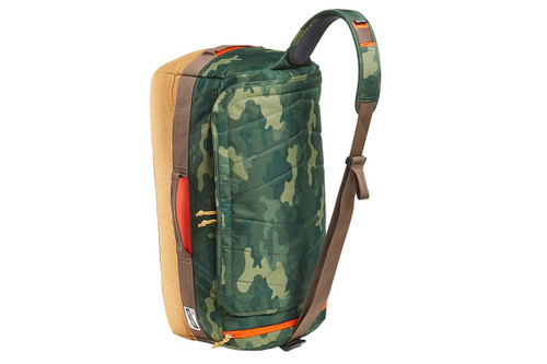 Kelty Dodger Duffel bag, Green Camo/Canyon Brown, standing on its end, showing shoulder strap with pad