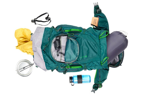 Kelty Coyote 65 backpack, Ponderosa Pine, shown overhead with an assortment of camping gear, including a sleeping bag, water bottle, rain jacket, headlamp, and binoculars