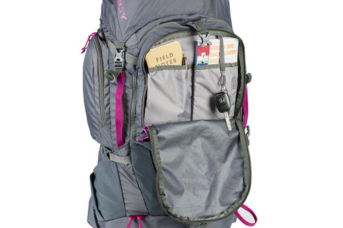 Kelty Women's Coyote 60 backpack, with front compartment unzipped to show multiple interior storage pockets