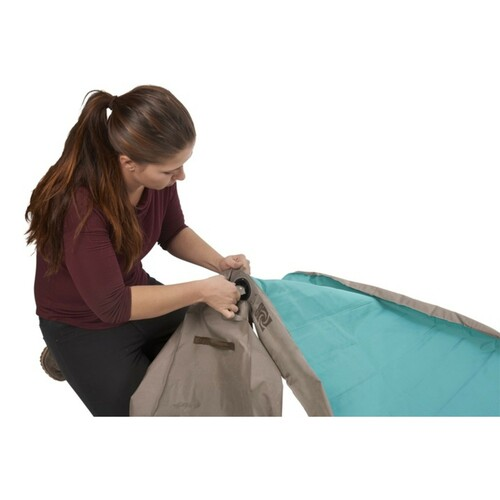 Woman attaching pump bag to Kelty Tru.Comfort Camp Bed Double