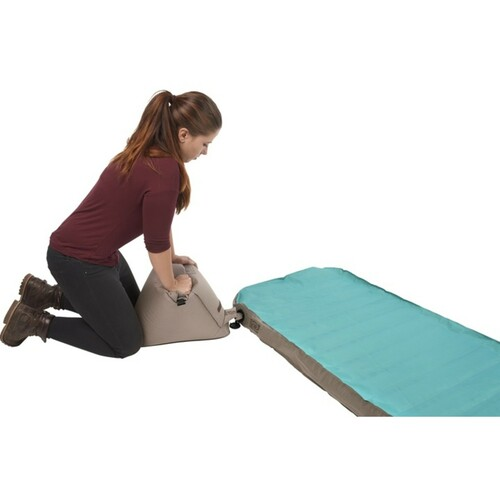 Woman inflating the Kelty Tru.Comfort Camp Bed Double with pump bag