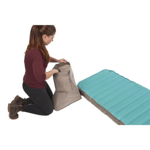 Woman closing the top flap of the Kelty Tru.Comfort Camp Bed Double pump bag