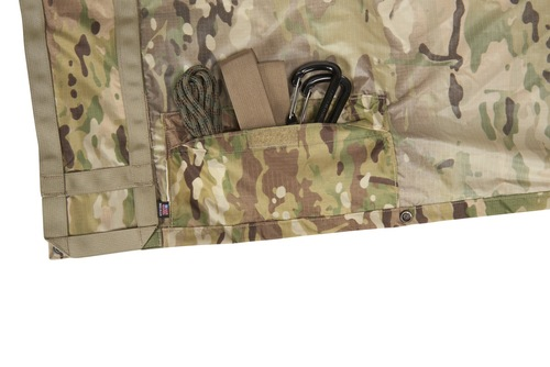 Close up of Kelty Field Craft Poncho FR, showing pocket with webbing, rope and carabiners
