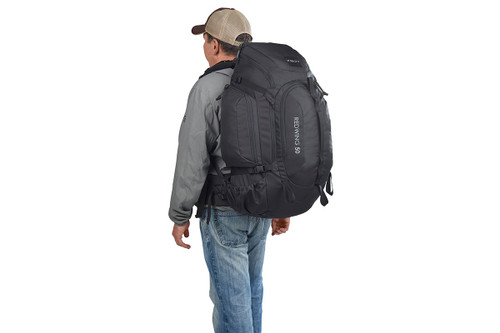 Man wearing Kelty Redwing 50 Tactical backpack, as seen from behind
