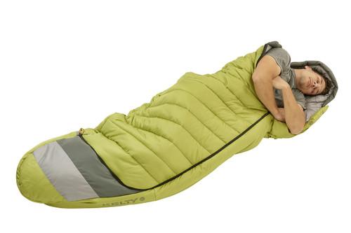 Man in Kelty Tuck 20 Degree Sleeping Bag, sleeping on his side