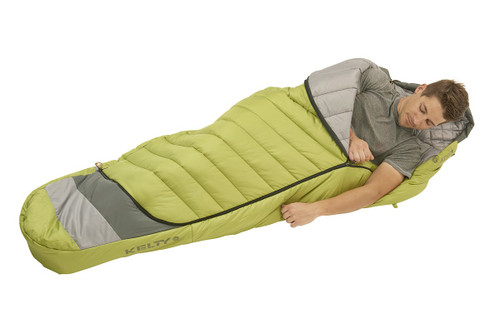 Man in Kelty Tuck 20 Degree Sleeping Bag, with arm extended out of bag