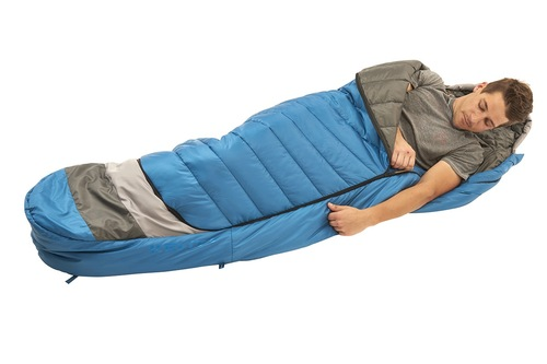 Man in Kelty Tuck 40 Degree Sleeping Bag, with arm extended outside of bag