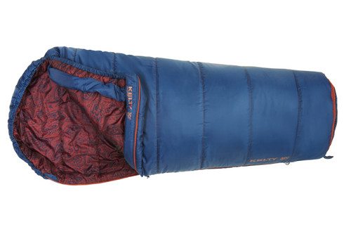Kelty Girl's Big Dipper 30 sleeping bag, blue, unzipped quarter length to show burgundy paisley pattern on interior fabric, with bottom section contracted to make bag shorter
