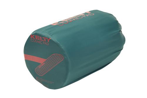 Kelty Cosmic Mummy Sleeping Pad packed inside turquoise cylinder-shaped storage bag