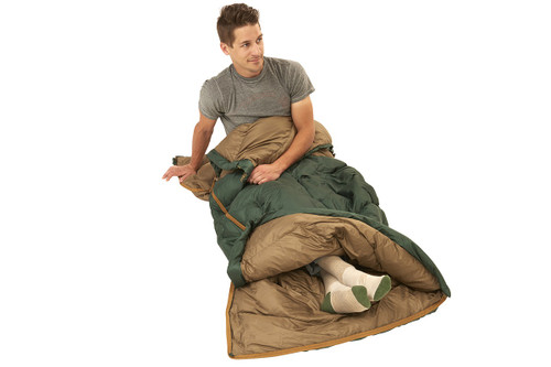 Man sitting in Kelty Galactic 30 Dridown sleeping bag, with bag unzipped at bottom for ventilation