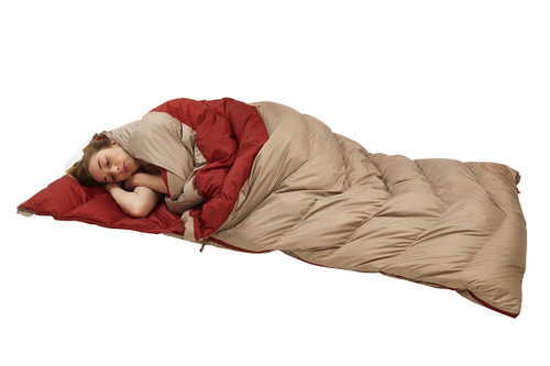 Woman in Kelty Women's Galactic 30 Dridown sleeping bag, sleeping on her side
