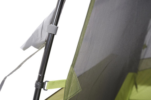 Close up of Kelty Sequoia 4 person tent, showing how rain fly attaches to tent poles with strips of hook-and-loop fabric