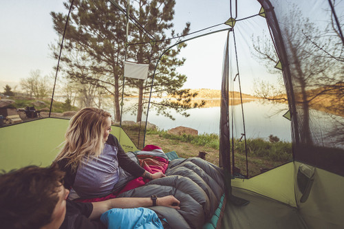 Couple in Kelty Sequoia 6 person tent, gazing at a small lake