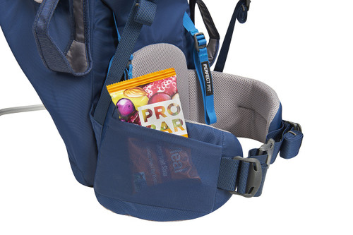 Close up of Kelty Journey PerfectFIT child carrier backpack, showing snacks inside of mesh pocket on waistbelt