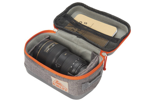 Medium Kelty Cache Box, grey, opened to show storage of Nikon DSLR camera zoom lens