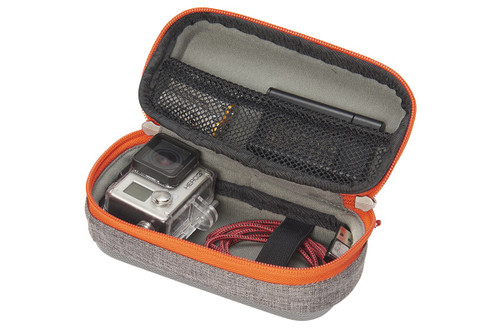 Small Kelty Cache Box, grey, opened to show storage of GoPro camera, cable, and memory card