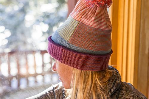 Woman wearing Kelty Boulder Beanie gazing out of window
