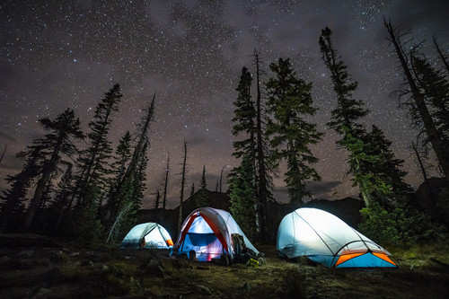 Kelty All Inn 2 Person Tent, blue colorway, at nighttime in the forest