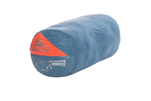Kelty All Inn 3 Person Tent, blue colorway, in cylinder shaped storage bag